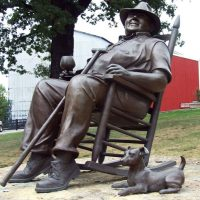 "Booker Noe's statue – along with his dog ""Dot"" – in front of Jim Beam Distilleries"
