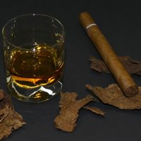 Glass of Bourbon with Cigar